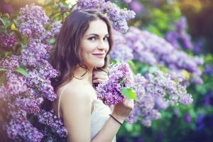 beautiful woman with purple flowers